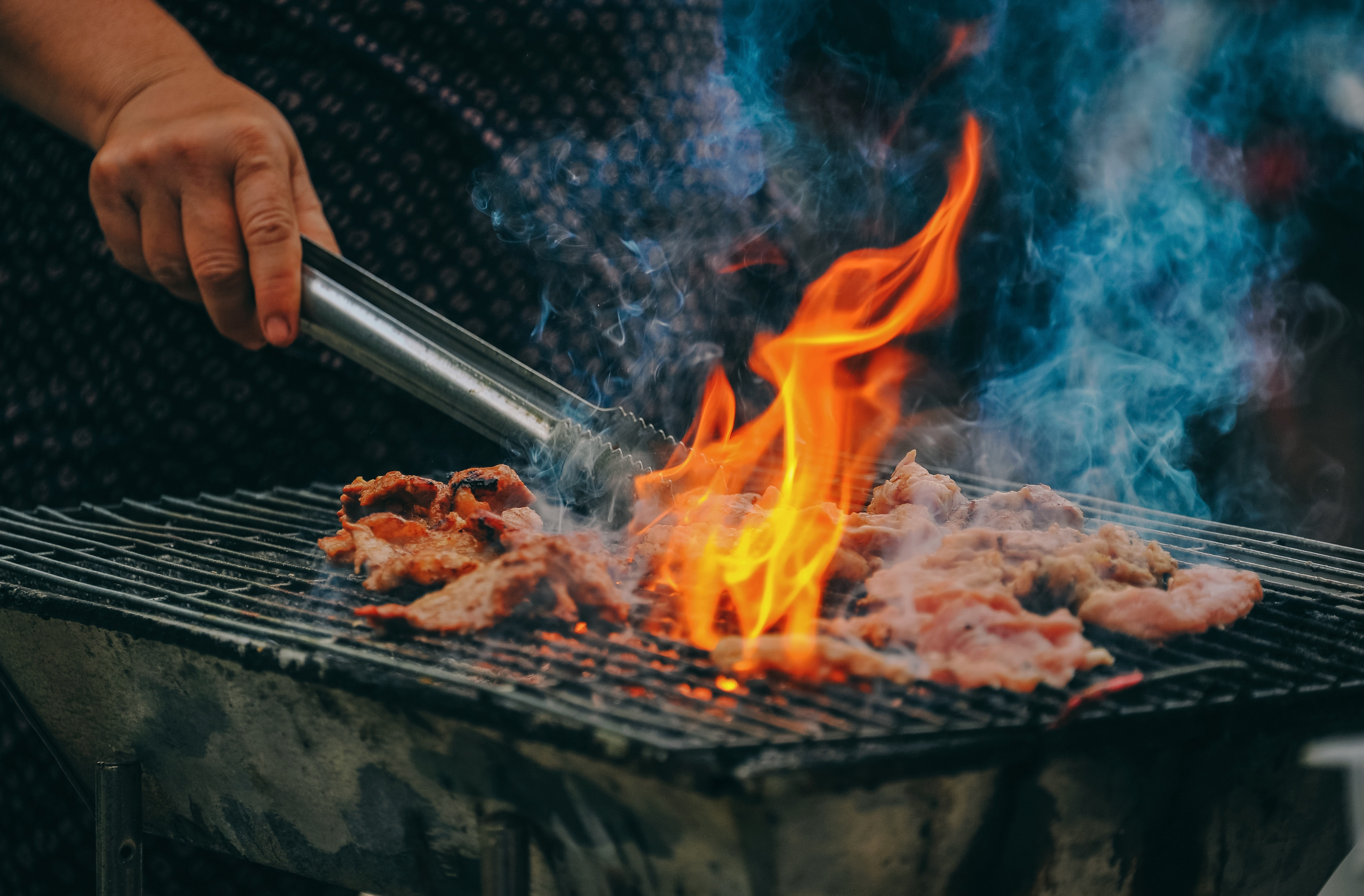 close-up-photo-of-man-cooking-meat-1482803